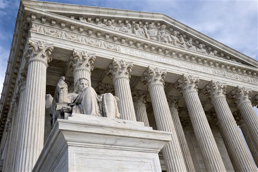 FILE - The Supreme Court in this Feb. 17, 2016 file photo. An Associated Press-GfK poll shows that nearly 2 in 3 Americans back Democrats' demands that the Republican-run Senate hold hearings and a vote on President Barack Obama's pick for the Supreme Court. (AP Photo/J. Scott Applewhite)