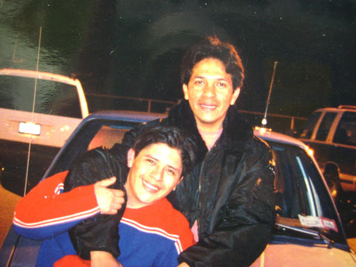 """In this circa 2000 photo taken with the camera's self timer and provided by Joselo Lucero, Marcello Lucero, top, playfully hugs his brother Joselo in Patchouge, N.Y. In 2008, a gang of racist white youths out hunting """"Mexicans"""" killed Marcello Lucero blocks from where Republican GOP presidential candidate Donald Trump is planning an appearance at an upcoming Republican fundraiser on Thursday, April 14, 2016. Some say the visit is opening old wounds, but others simply oppose the billionaire's positions on building a wall on the Mexican border and other immigration stances. (Joselo Lucero via AP)"""