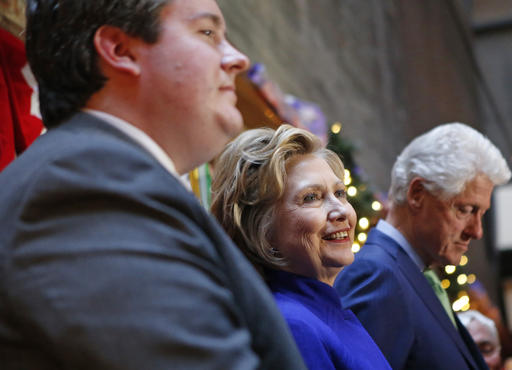 Democratic presidential candidate Hillary Clinton, center, and her husband, former President Bill Clinton, stand on the stage as they are introduced during an appearance before Irish American supporters at a midtown Manhattan hotel bar one day ahead of the New York primary, Monday, April 18, 2016, in New York. (AP Photo/Kathy Willens)