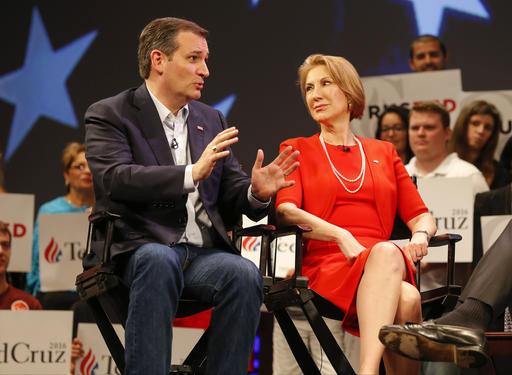 In this photo taken March 11, 2016, Republican presidential candidate, Sen. Ted Cruz, R-Texas speaks to Carly Fiorina in Orlando, Fla., Friday, March 11, 2016. According to an AP Source: Cruz has picked Fiorina as his running mate (AP Photo/Mike Carlson)