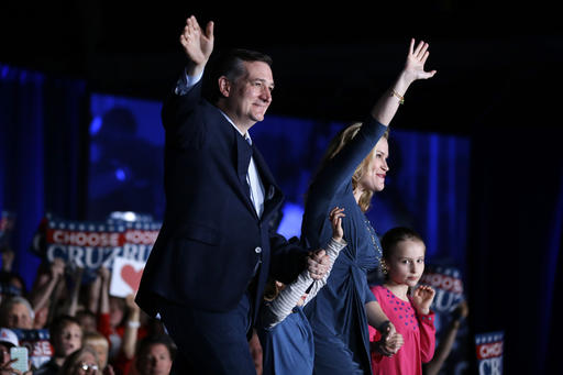 Republican presidential candidate Sen. Ted Cruz, R-Texas, waves with his wife Heidi and daughters, Caroline, right, and Catherine, during a rally at the Indiana State Fairgrounds in Indianapolis, Monday, May 2, 2016. (AP Photo/Michael Conroy)