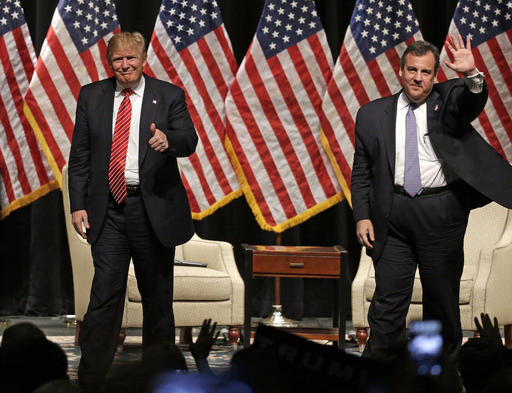FILE - In this March 14, 2016 file photo, Republican presidential candidate Donald Trump gives a thumbs up as New Jersey Gov. Chris Christie waves to the crowd as they walk off the stage after a rally at Lenoir-Rhyne University in Hickory, N.C. Christie's decision to endorse Donald Trump back in February brought him plenty of derision at the time. But it's bringing rewards now that it's clear he bet on the winner. (AP Photo/Chuck Burton, File)