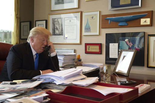 Republican presidential candidate Donald Trump takes a telephone call from his daughter Ivanka during an interview with The Associated Press in his office at Trump Tower in New York, Tuesday, May 10, 2016. (AP Photo/Mary Altaffer)
