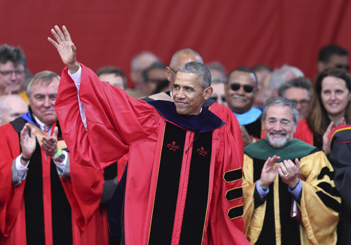 President Barack Obama waves as he leaves Rutgers graduation ceremonies Sunday, May 15, 2016 in Piscataway, N.J. President Obama delivered a commencement address at Rutgers University. (AP Photo/Mel Evans)