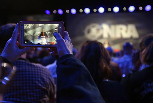 A National Rifle Association photographs Republican presidential candidate Donald Trump as he speaks at the NRA convention, Friday, May 20, 2016, in Louisville, Ky. (AP Photo/Mark Humphrey)