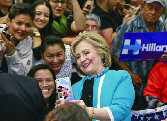 FILE - In this May 5, 2016 file photo, Democratic presidential candidate Hillary Clinton takes a photo with supporters at the end of a campaign stop at East Los Angeles College in Los Angeles.  Bernie Sanders' campaign is mining deep into voter data from Hispanic enclaves, scouting for hidden supporters in an effort to undercut Hillary Clinton in a contest that he has vowed to fight to the end. Clinton ran up a 2-1 advantage with Hispanics in her 2008 win in California over Barack Obama and is making a strong push to do that again.  (AP Photo/Damian Dovarganes)