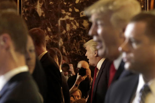 Republican presidential candidate Donald Trump is reflected in a Trump Tower elevator following his news conference in New York, Tuesday, May 31, 2016. (AP Photo/Richard Drew)