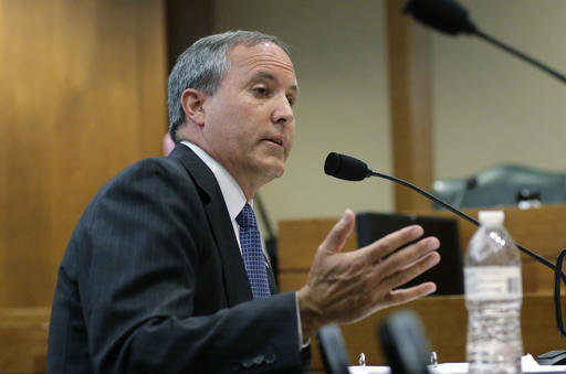 Texas Attorney General Ken Paxton speaks during a hearing in Austin, Texas. Paxton moved June 3, 2016, to muzzle a former state regulator who says he was ordered in 2010 to drop a fraud investigation into Trump University for political reasons. Paxton's office issued a cease and desist letter to former Deputy Chief of Consumer Protection John Owens after he made public copies of a 14-page internal summary of the state's case against Donald Trump for scamming millions from students of his namesake real estate seminar. (AP Photo/Eric Gay)