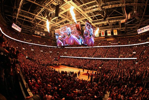 Fans stand before the start of the first half of Game 3 of basketball's NBA Finals between the Cleveland Cavaliers and Golden State Warriors at Quicken Loans Arena in Cleveland, Wednesday, June 8, 2016. (AP Photo/Ron Schwane)