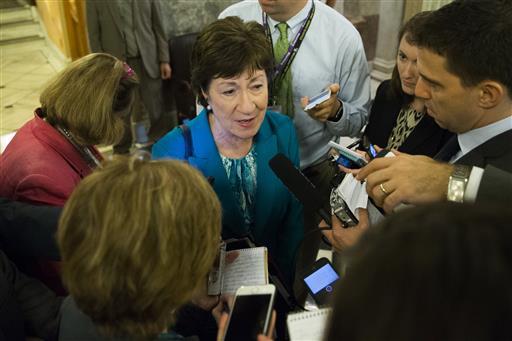 Sen. Susan Collins, R-Maine speaks to reporters on Capitol Hill in Washington, Thursday, June 23, 2016, after a procedural vote on gun legislation. (AP Photo/Evan Vucci)