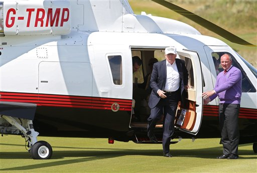 US presidential candidate Donald Trump, second right, arrives by helicopter for a tour at the Trump International Golf Links at Balmedie, near Aberdeen, Scotland, Saturday June 25, 2016.  Presidential hopeful Donald Trump is on a short break away from his presidential campaign. (Andrew Milligan / PA via AP) UNITED KINGDOM OUT - NO SALES - NO ARCHIVES