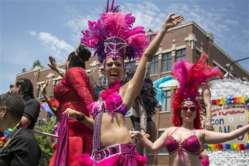 housands gather on the North Side of Chicago for the 47th annual Chicago Pride Parade on Sunday, June 26, 2016. (Ashlee Rezin/Chicago Sun-Times via AP)