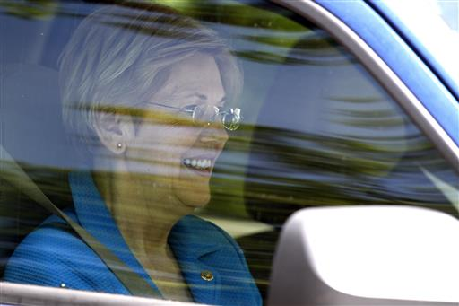 Sen. Elizabeth Warren, D-Mass., departs the Washington home of Democratic presidential candidate Hillary Clinton. (AP Photo/Paul Holston)