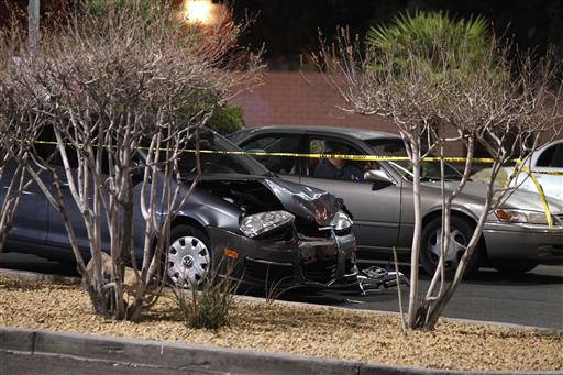 a damaged car is seen at the scene of a fatal road rage incident near the corner of Tropicana Avenue and Rainbow Boulevard in Las Vegas. Authorities say a man shot a motorist to death in a vehicle with two children in the backseat in an apparent road-rage confrontation during rush-hour several miles west of the Las Vegas Strip. Nearly eight of every 10 U.S. drivers admit expressing anger, aggression or road rage at least once in the previous year, according to a new survey released Thursday, July 13, 2016, by the AAA Foundation for Traffic Safety. It could be following too closely, yelling at another driver, cutting them off or making angry gestures. (John Locher/Las Vegas Review-Journal via AP, File)
