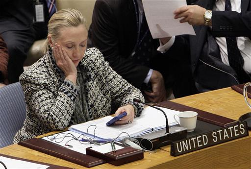 Then-Secretary of State Hillary Clinton checks her mobile phone after her address to the Security Council at United Nations headquarters. (AP Photo/Richard Drew, File)