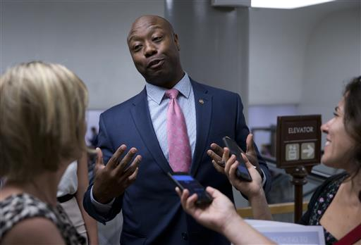 Sen. Tim Scott, R-S.C., talks with reporters on Capitol Hill in Washington. Scott candidly described being stopped by police and Capitol Hill cops because of the color of his skin. It's an experience all too familiar to many of his African-American colleagues in Congress. A day after Scott's personal recounting on the Senate floor, several lawmakers said July 14, that they have had similar experiences. (AP Photo/Alex Brandon, File)