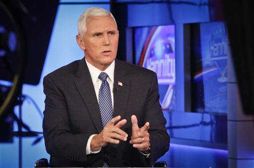 Indiana Gov. Mike Pence speaks during an interview with FOX News Channel's Sean Hannity. (AP Photo/Bebeto Matthews)