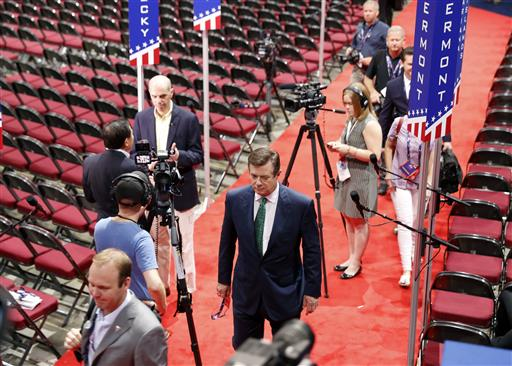Trump Campaign Chairman Paul Manafort walks off the floor of the Republican National Convention at Quicken Loans Arena after talking to reporters, Sunday, July 17, 2016, in Cleveland. (AP Photo/Carolyn Kaster)