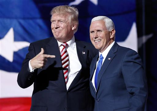 Republican Presidential Candidate Donald Trump, give his running mate Republican Vice Presidential Nominee Gov. Mike Pence of Indiana a kiss after Pence's acceptance speech during the third day of the Republican National Convention in Cleveland, Wednesday, July 20, 2016. (AP Photo/J. Scott Applewhite)