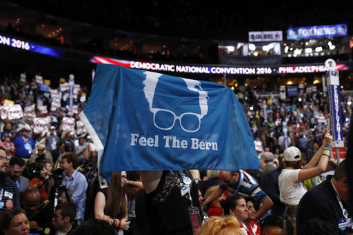 A delegate shows support for former Democratic Presidential candidate, Sen. Bernie Sanders, I-Vt., during the first day of the Democratic National Convention in Philadelphia , Monday, July 25, 2016. (AP Photo/Carolyn Kaster)