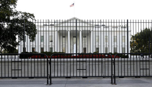 FILE - In this Sept. 22, 2014, file photo. the perimeter fence sits in front of the White House fence on the North Lawn along Pennsylvania Avenue in Washington. Most young Americans say the Republican and Democratic parties don't represent them, a critical data point after a year of ferocious presidential primaries that forced partisans on both sides to confront what _ and whom _ they stand for. A new GenForward poll also shows that disconnect holds true across racial and ethnic groups, with just 28 percent of young adults overall saying two parties do a good job of representing the American people. (AP Photo/Carolyn Kaster, File)