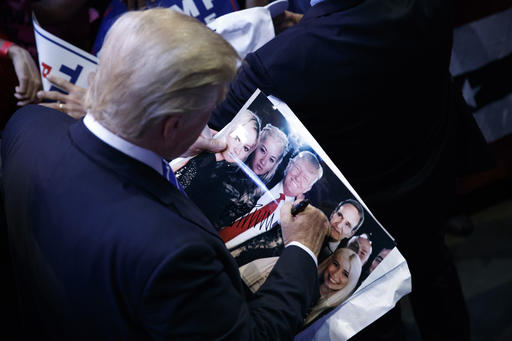 Republican presidential candidate Donald Trump signs autographs during a campaign rally at the BB&T Center, Wednesday, Aug. 10, 2016, in Sunrise, Fla. (AP Photo/Evan Vucci)