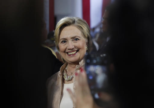 Democratic presidential candidate Hillary Clinton poses for a cell phone photo with audience members after speaking at campaign event at John Marshall High School in Cleveland, Wednesday, Aug. 17, 2016. (AP Photo/Carolyn Kaster)