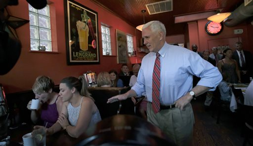 Republican vice presidential candidate, Indiana Gov. Mike Pence, right, surprises patrons at Millie's Diner in Richmond, Va. Saturday, Aug. 27, 2016, during an impromptu visit by the candidate to the popular restaurant. (Bob Brown/Richmond Times-Dispatch via AP)