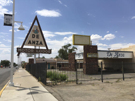 FILE - This June 24, 2016 file photo, shows the abandoned De Anza Motor Lodge in Albuquerque, N.M., along Route 66. Some sites linked to key moments of the nation's civil rights are overlooked, neglected and at-risk of being forgotten. In another part of New Mexico, there is a ghost town of a once thriving all-black settlement in the New Mexico desert rarely appears on tourist maps. (AP Photo/Russell Contreras, File)