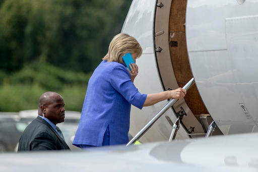 Democratic presidential candidate Hillary Clinton boards her plane at the Cincinnati Municipal Lunken Airport in Cincinnati, Ohio, Wednesday, Aug. 31, 2016, after speaking at the American Legion's 98th Annual Convention. (AP Photo/Andrew Harnik)