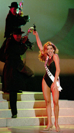 """FILE - In this Friday, May 17, 1996 file photo, new Miss Universe Alicia Machado participates in a show after winning the title in Las Vegas. In the opening presidential debate in the 2016 election, after Donald Trump questioned Hillary Clinton's looks and stamina, Clinton quickly pivoted to the issue of sexism. """"This is a man who called women pigs, slobs and dogs,"""" she said, asserting that Trump, as boss of the Miss Universe Pageant in 1996, labeled the winner """"Miss Piggy"""" after she gained weight. (AP Photo/Lennox McLendon)"""