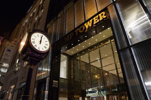 A clock sits outside of Trump Tower at midnight on, Saturday, Oct. 8, 2016, in New York. Republican presidential candidate Donald Trump blurted out lewd and sexually charged comments about women as he waited to make a cameo appearance on a soap opera in 2005, a revelation that led him to issue a rare apology. (AP Photo/ Evan Vucci)