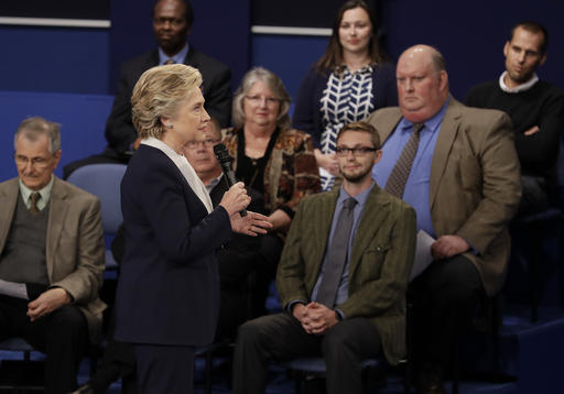 Democratic presidential nominee Hillary Clinton speaks during the second presidential debate with Republican presidential nominee Donald Trump at Washington University in St. Louis, Sunday, Oct. 9, 2016. (AP Photo/John Locher)
