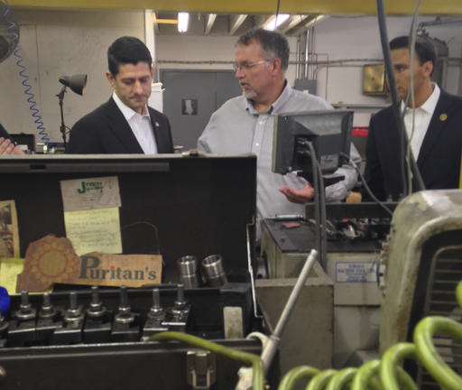 House Speaker Paul Ryan of Wis., Rep. Ryan Costello, R-Pa., right, and Scott Johnson, center, owner of J-Tech tour the company in Chester Springs, Pa., on Thursday, Oct. 6, 2016. For Ryan, October is now all about protecting the Republican majority of the House _ and his own job as speaker. The Wisconsin Republican can't ignore Donald Trump. Nor can he offend Trump's millions of voters, who many House GOP candidates need to survive next month's elections. Yet amid the remarkable spectacle of the party's White House nominee and highest elected official practically at war, Ryan said Oct. 10, he's not going to lift a finger for Trump, or even be seen with him. (AP Photo/Alan Fram)