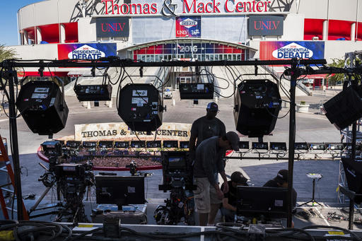 Television crews set up outside of the presidential debate site Monday Oct. 17, 2016 at the University of Nevada, Las Vegas in Las Vegas as preparation continue for the final debate between Democratic presidential nominee Hillary Clinton and Republican presidential nominee Donald Trump. (AP Photo/J. David Ake)