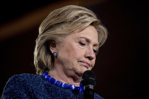 Democratic presidential candidate Hillary Clinton pauses while speaking at a rally at Theodore Roosevelt High School in Des Moines, Iowa, Friday, Oct. 28, 2016. (AP Photo/Andrew Harnik)