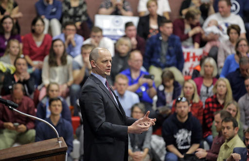 FILE - This Oct. 21, 2016, file photo, Independent presidential candidate Evan McMullin speaks during a rally, in Draper, Utah. Two months after he jumped into the presidential race as a political unknown, McMullin is surging in Utah polls and drawing large crowds of Republican-leaning voters fed up with Donald Trump's crudeness and antics. (AP Photo/Rick Bowmer, File)