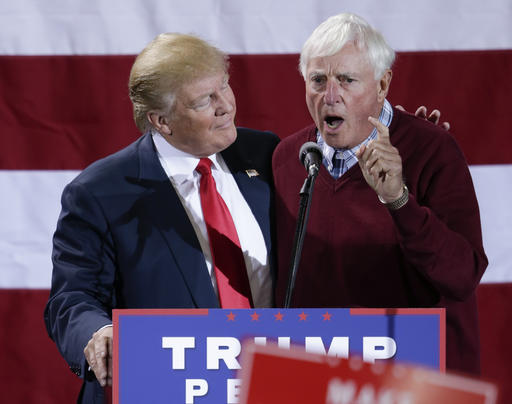 Republican presidential candidate Donald Trump is endorsed by former coach Bobby Knight, during a campaign rally in Grand Rapids, Mich., Monday, Oct. 31, 2016. (AP Photo/Nati Harnik)