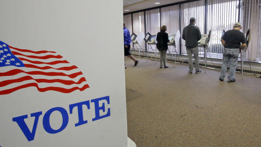 People vote during early voting for the 2016 General Election at the Salt Lake County Government Center on Tuesday, Nov. 1, 2016, in Salt Lake City. Hillary Clinton may not be accumulating the type of early-vote advantage her campaign wanted, but she continues to maintain an apparent edge over Donald Trump, with roughly one-fourth of all expected ballots cast in the 2016 election. (AP Photo/Rick Bowmer)