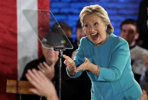 Democratic presidential candidate Hillary Clinton gestures as she takes the stage during a campaign rally Sunday, Nov. 6, 2016, in Manchester, N.H. (AP Photo/Steven Senne)