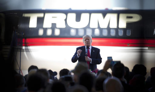 FILE - In this Saturday, Feb. 27, 2016 file photo, Republican presidential candidate Donald Trump stands in front of his airplane as he speaks during a rally in Bentonville, Ark. (AP Photo/John Bazemore)