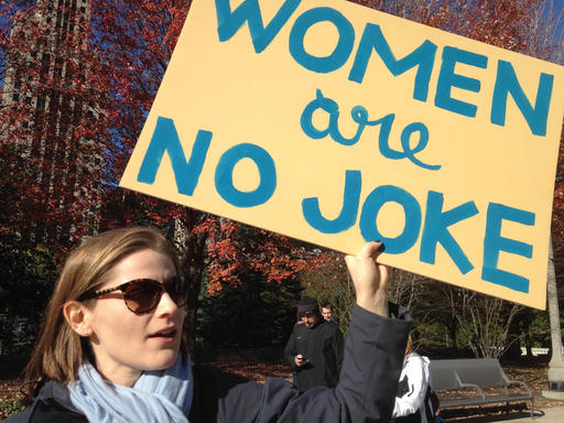 """Protester Sonja Spray carries a sign reading """"WOMEN are NO JOKE"""" in Chicago's Millennium Park on Saturday, Nov. 12, 2016. Several hundred people joined a Chicago demonstration to protest the election of Donald Trump as president. (AP Photo/Carla K. Johnson)"""