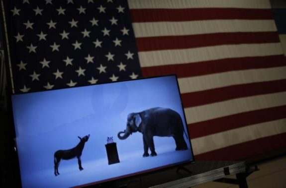 The mascots of the Democratic and Republican parties, a donkey for the Democrats and an elephant for the GOP, are seen on a video screen at Democratic U.S. presidential candidate Hillary Clinton's campaign rally in Cleveland, Ohio in this March 8, 2016 filem photo. REUTERS/Carlos Barria