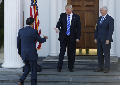 President-elect Donald Trump, center, and Vice President-elect Mike Pence, right, greet Mitt Romney, left, as he arrives at Trump National Golf Club Bedminster clubhouse in Bedminster, N.J., Saturday, Nov. 19, 2016. (AP Photo/Carolyn Kaster)
