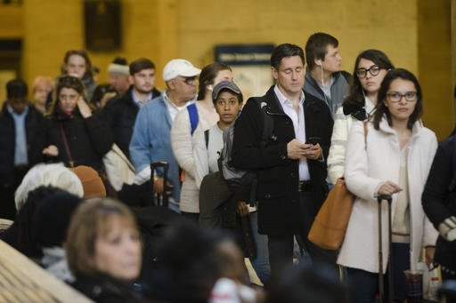 Travelers stand in line to board a train at the 30th Street Station ahead of the Thanksgiving Day holiday, in Philadelphia, Tuesday, Nov. 22, 2016. Almost 49 million people are expected to travel 50 miles or more for the holiday, the most since 2007, according to AAA.  (AP Photo/Matt Rourke)