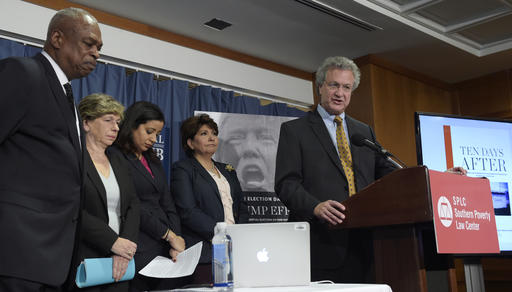 Richard Cohen, president of the Southern Poverty Law Center, right, speaks during a news conference at the National Press Club in Washington, Tuesday, Nov. 29, 2016. Cohen, along with, from left, Wade Henderson, President and CEO of The Leadership Conference on Civil and Human Rights, American Federation of Teachers President Randi Weingarten, Brenda Abdelall, with Muslim Advocates, and Janet Murguia, the President and CEO of the National Council of La Raza, called on President-elect Donald Trump to publicly denounce racism and bigotry. (AP Photo/Susan Walsh)