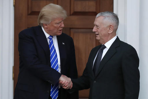 FILE - In this Nov. 19, 2016, file photo, President-elect Donald Trump shakes hands with retired Marine Corps Gen. James Mattis as he leaves Trump National Golf Club Bedminster clubhouse in Bedminster, N.J. Trump said at a rally on Dec. 1, that he will nominate Mattis as defense secretary. (AP Photo/Carolyn Kaster, File)