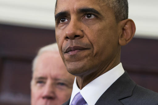 FILE - In this Feb. 11, 2015, file photo, Vice President Joe Biden listens at left, as President Barack Obama speaks about the Islamic State group in the Roosevelt Room of the White House in Washington. The White House sought to show that the array of U.S. military actions on President Barack Obama's watch have been on solid legal footing, with a new report on Dec. 5, 2016, shedding light on how an evolving interpretation of a 9/11-era law has been used to justify new and emerging threats overseas.  (AP Photo/Evan Vucci)