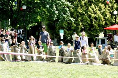 Competitors line up for the sack race at the 2011 Independence Day Picnic (Image: CHS)