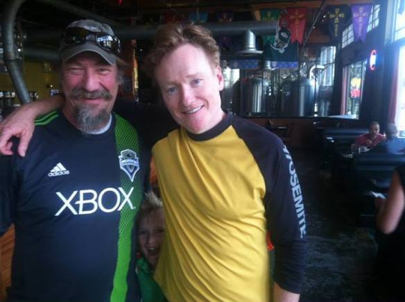 """Conan and his son stopped into our Elysian Capitol Hill Brewpub for lunch today! Thanks for showing your support Conan. Cheers! — with David Buhler."" (Elysian via Facebook)"
